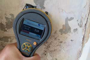 Atlantis survey a wall to diagnose rising damp in Warrington property