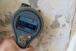 Atlantis survey a wall to diagnose rising damp in Warrington property